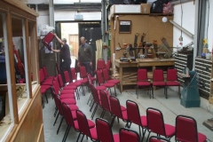Andy and Peter move benches, machinery and set out chairs for the Comedy Festival …