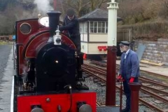 Richard watches Steve closely while filling No. 7 with water