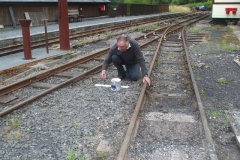 … Dick attends to paint on a fouling board missed earlier in the season ...