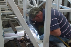 … and welds them into the frames of carriage No. 24 to stabilise the Guard's compartment partition …