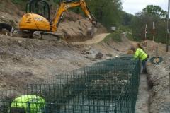 Southern Extension. Pont y Goedwig Deviation Project. Monday, 27.4.2020. After the recent superb weather, it is cooler as Socially Distant work continues, assembling gabion baskets and filling them by hand …