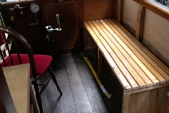 … and the bench seat in the Guard's compartment of carriage No. 20 has been assembled, storage lockers tucked away, and the new brake handle fitted.