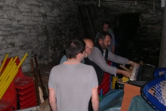 In the Corris Institute cellar, members clear a way to borrow trestle tables for the Model Railway Exhibition …