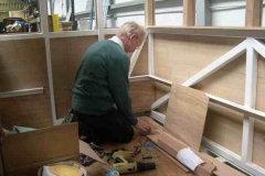 (July) Peter Gray is fixing the panelling in the south end of carriage No. 22.