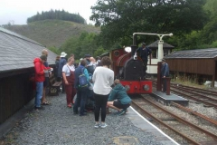Sunday, 8.8.2021. Trefor and Mike demonstrate watering No. 7 as many of the passengers look on.