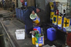 Trefor then decants oil into new (hopefully) leak-proof colour coded containers ...
