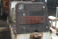 ... together with a headlight and sound fixings for the grill and manufacturer's name plate.