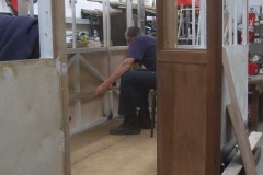 ... where, after temporarily fitting the disabled access door, he measures up ...