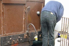 … while Bob (out of sight underneath) and Chris remove bolts (with difficulty!) from the underframe of carriage No. 20 …