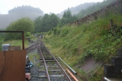 … while Tony clears undergrowth in the rain, south of the Carriage Shed.