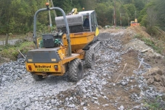 With the bulk of the stone moved, a start was made to clean up the various deposit sites with the smaller excavator.