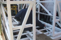 … while our Fabricator in Chief goes over footprints, etc., on the frames of carriage No. 24. It now looks all white!
