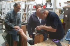 Nearby, Tony shows a leg while Charles cuts a waggon transom timber …