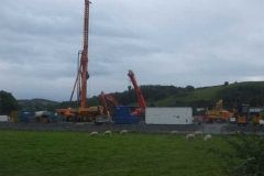 New Dyfi Bridge scheme. Saturday, 1.9.2021. Out of interest, the piling rig for the new viaduct piers arrived late in the week (after causing chaos negotiating the junction by Machynlleth Clock Tower) and was soon put to work.