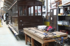 … and when it is raining, is touching up the paintwork on the handrails of carriage No. 23.