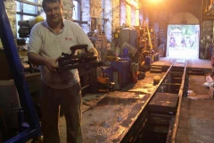 Wednesday, 17.9.14. Patrick proudly holds the spark arrestor components and blower ring from No. 7 in a deserted Engine Shed …