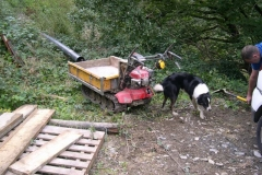 Over lunch, Richard's dog christens the hydro boys' tracked barrow!