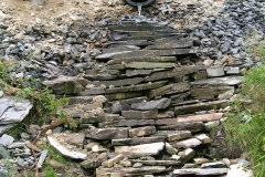 Sunday, 18.9.2016. A cascade has been formed in recovered slate to control erosion below the culvert at Ch. 68.
