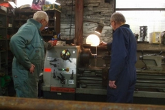 … while Bob and Chris turn a sleeve in the lathe – boring!