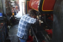 Meanwhile, Tony has been cleaning inside No. 7's sandboxes, and is here priming them ready for painting in due course.