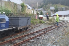 Sunday, 11.4.2021. On a bitterly cold and wet day, Josh and Jack cut and clear growth from the wall and fence above the station site at Corris …