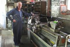 … while Bob turns more metal on the lathe.