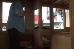 Pete and Charles are fitting glass in carriage No. 23 …