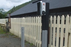 Rails have been cut, planted and primed to protect the ev charging point from errant road vehicles.