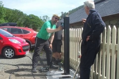 Tuesday, 15.6.2021. An electric vehicle charging point (for volunteer use) is offered up for installation at Maespoeth …