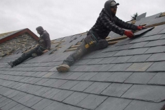 At the rear, good progress has been made on slating …