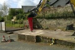 Work starts to remove the concrete ramp.