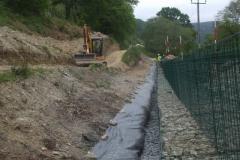 … until the whole of the length behind the gabions has been filled.