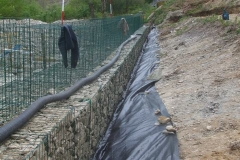 With the geotextile in position, the pipe can be fed in …