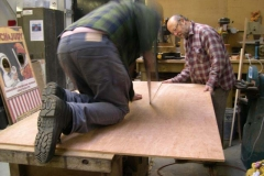 Neil cuts new boards assisted by Charles …