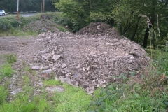 … having roughly levelled a platform ready to receive stone for the new embankment base.