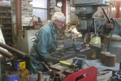 … while in the Engine Shed, Bob is milling out sections of channel to make up more track jacks …