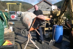 … and Dick is back mixing concrete for the retaining wall, in the warming sun.