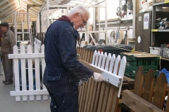 Phil re-starts priming the fencing panels …