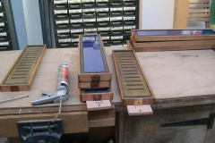 The clerestory window frames for carriage No. 22 are laid out for re-sealing …