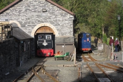 An uncommon sight as No. 11 emerges into the Sunday sunlight while No 6 waits in the platform to return passengers to Corris...