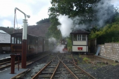 Sunday, 23.9.2018. It was wet overnight so steam hangs as the air pump on No. 7 is started outside the Signal Box at Maespoeth.