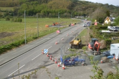 Tuesday 11th May 2021. Work started on the New Dyfi Bridge road scheme at the end of April, and by 11th May physical work was in progress heading past the former Corris Railway Machynlleth (Low Level) Station – just visible past the parked cars at right.