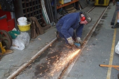 In between moves, advantage was taken to smooth lumpy welds in the track …