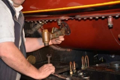Patrick starts the removal of a clack valve while...