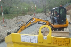 … and dumper operators, so that material was placed exactly where required.