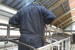 Adrian welds more steel into the roof of carriage No. 24 …