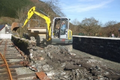 Corris Station Project. Monday, 25.2.2019. The wall between railway and the access track to Braichgoch Farm is being demolished during half-term …