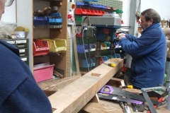 Tuesday, 19.2.2019. Bill cuts out a mortise on the next waggon solebar, assisted by Graham …