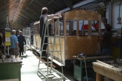 After more careful measuring and comparison, the first roof board on carriage No. 23 is aligned …