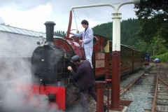Once outside and coupled to the train, Ioan and Jack water No. 7.